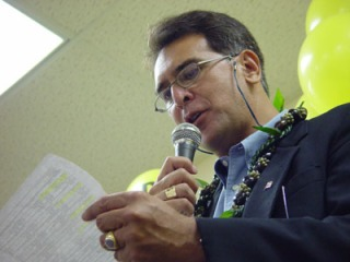 Then Hawaii Democratic Party Chair, Sen. Galuteria reads off the results at Senator Daniel Inouye's campaign headquarters in 2004.